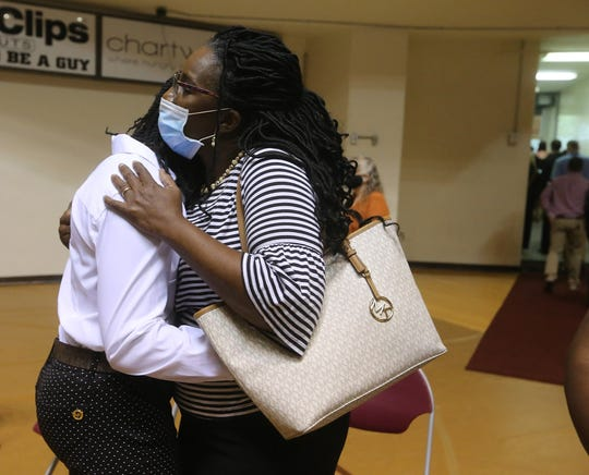 Pam King hugs her daughter Frances, a sophomore, after the memorial service for women's basketball coach Noel Johnson, in D.L. Ligon Coliseum, Saturday, June 20, 2020. Johnson died of ovarian cancer June 9, 2020.