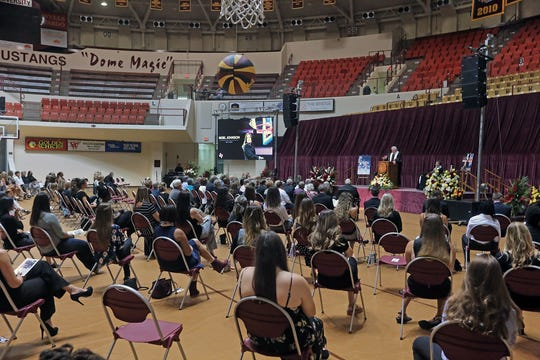 Dozens gathered, but adhered to social distancing, at the memorial service for women's basketball coach Noel Johnson, in D.L. Ligon Coliseum, Saturday, June 20, 2020. Johnson died of ovarian cancer June 9, 2020