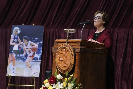 """Debbie Barrow, MSU director of board and government relations, sings """"For Good"""" at the closing of the memorial service for women's basketball coach Noel Johnson, in D.L. Ligon Coliseum, Saturday, June 20, 2020. Johnson died of ovarian cancer June 9, 2020."""