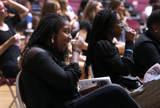 Andrea Carter laughs and wipes away a tear while watching a video at the memorial service for women's basketball coach Noel Johnson, in D.L. Ligon Coliseum, Saturday, June 20, 2020. Johnson died of ovarian cancer June 9, 2020.