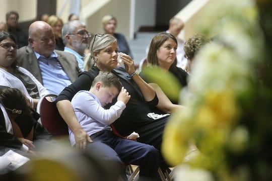 Members of Johnson's family watch the memorial service for women's basketball coach Noel Johnson, in D.L. Ligon Coliseum, Saturday, June 20, 2020. Johnson died of ovarian cancer June 9, 2020.