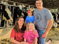 The Tremelling family is selling T-shirts to raise money to help dairy farmers. Kristy, in red, daughters Emily, in blue and Kaylee, in pink, and Justin, in gray.