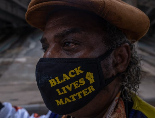 "A resident of Tulsa, Oklahoma, sports a ""Black Lives Matter"" face mask during celebrations of Juneteenth in Greenwood, the site of the 1921 race massacre, on June 19, 2020."