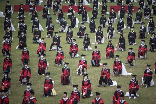 Wuhan University graduates wear face masks during their graduation ceremony at Wuhan University on June 20, 2020 in Wuhan, China. More than 600 student representatives attended the graduation ceremony, while 15000 graduates watched the live webcast. Since June 13, 2020 the response level of public health emergencies in Hubei Province has been reduced to level 3. Wuhan's health commission said that the city had no asymptomatic cases as of June 15, and there are no more close contacts under medical observation.
