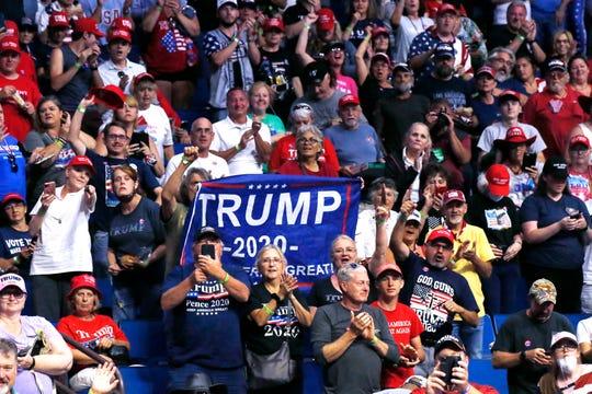 President Donald Trump supporters cheer Eric Trump, the son of President Donald Trump, not pictured, before a Trump campaign rally in Tulsa, Okla., Saturday, June 20, 2020.
