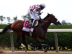 Tiz the Law, ridden by jockey Manuel Franco, crosses the finish line to win the 152nd running of the Belmont Stakes.
