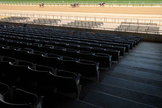 There are no spectators during the 2nd race of the day before the 152nd running of the Belmont Stakes at Belmont Park on June 20 in Elmont, N.Y.