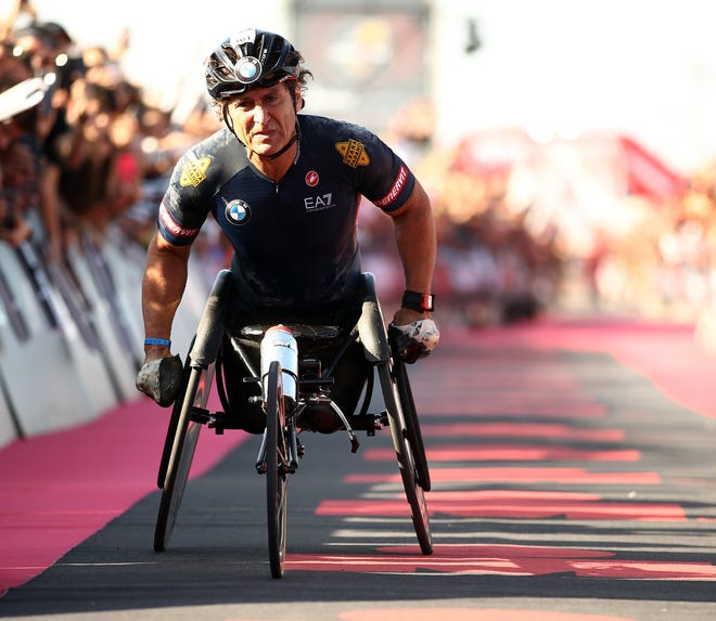 Alex Zanardi, shown here crossing the finish line of the 2019 IRONMAN Italy.
