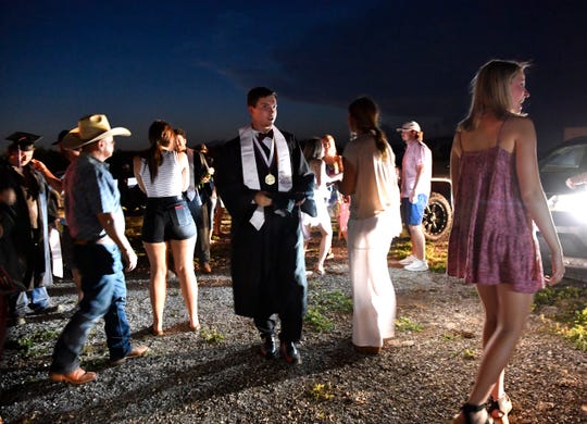 Eula graduates and families embrace and take pictures after commencement at Abilene's Town & Country Drive-In May 22.