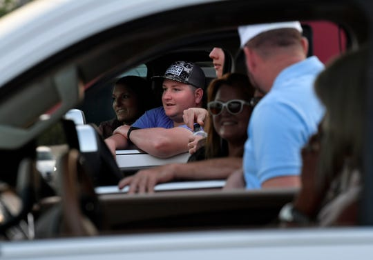Families and friends wait in their cars for the Eula High graduation to begin May 22. The district rented the entire drive-in theater for the evening.