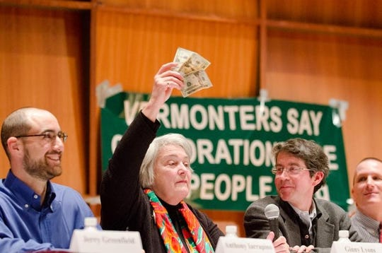 """Sen. Virginia Lyons, center, participates in a panel discussion titled, """"Are Corporations People? Citizens Respond to Citizens United,"""" while fellow panelists Anthony Iarrapino, left, and John Bonifaz, right, look on at Saint Michael's College in Colcheter, Vt., on Feb. 27, 2012."""