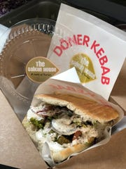 The vegan döner kebab replaces meat with falafel and has a dairy-free sauce along with the usual lepinja bread, shredded lettuce, cabbage, onions, cucumbers and tomato.