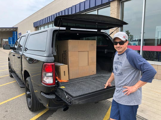 Tim Gabriel uses his 2019 Ram 1500 Big Horn to pick up a new clothing dryer from Lowe's on June 21, 2020. He says the truck is great for hauling children's toys and things when it's time to visit grandparents.