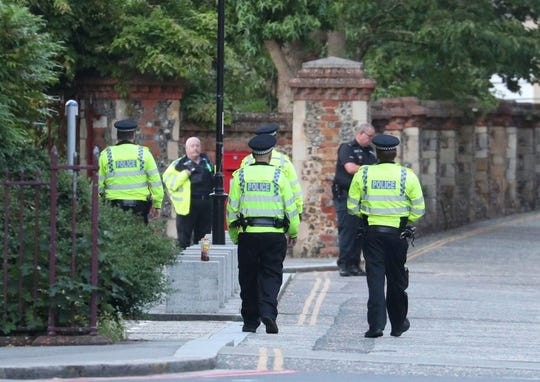 "Police arrive at Forbury Gardens in the town centre of Reading, England, where they are responding to a ""serious incident"" Saturday, June 20, 2020."