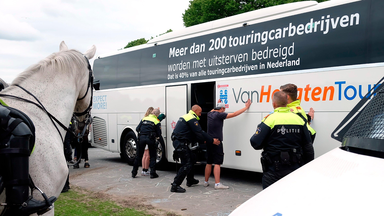 Dutch police arrest 400 after virus protest turns violent