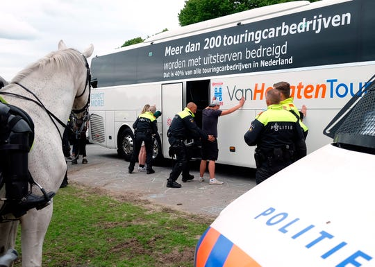 Protesters are voluntarily searched by police, during a demonstration targeting the government's handling of the coronavirus crisis Sunday at Malieveld, the Hague, Netherlands.
