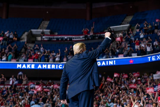 President Donald Trump arrives on stage Saturday to speak at a campaign rally at the BOK Center in Tulsa, Okla.
