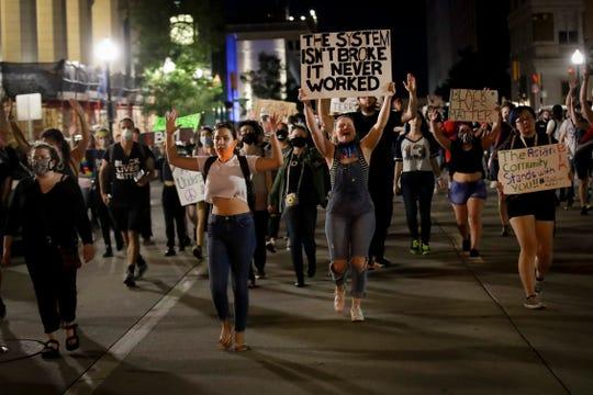 Demonstrators march near the BOK Center where President Trump is holding a campaign rally in Tulsa, Okla., Saturday, June 20, 2020.