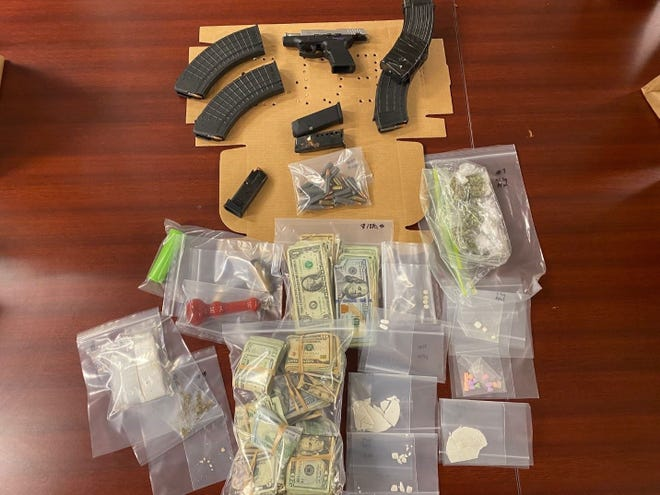 Two Fort Myers men were charged with drug violations after a search warrant on a Lemon Street home foundnarcotics, a gun, ammunition and cash.