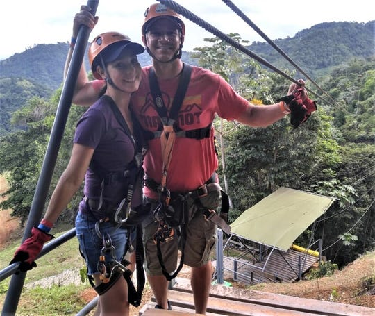 Sean and Julissa Swarner ziplining in Puerto Rico, one of his tamer adventures.