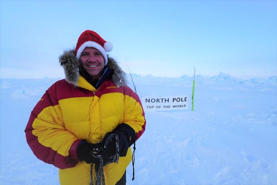 Willard native Sean Swarner wears his Santa hat after reaching the North Pole in 2017. He's the only person to complete the Explorers Grand Slam and finish the Ironman Triathlon.