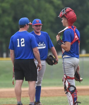 MacLeod coach Brody Ninemire, pitcher Brett Manes and catcher Britton Smith have a chat on the mound during the team's 12-4 victory over North Central Arkansas on Saturday night.