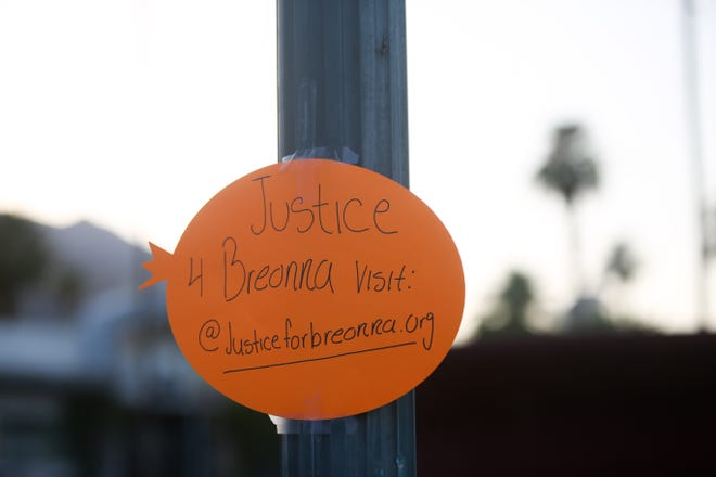 A sign demanding justice for Breonna Taylor sits taped to a pole at Frances Stevens Park in Palm Springs, Calif. on Saturday, June 20, 2020.
