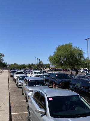 Cars stretch for several miles outside of Desert West Sports Complex waiting for testing, June 20 2020.
