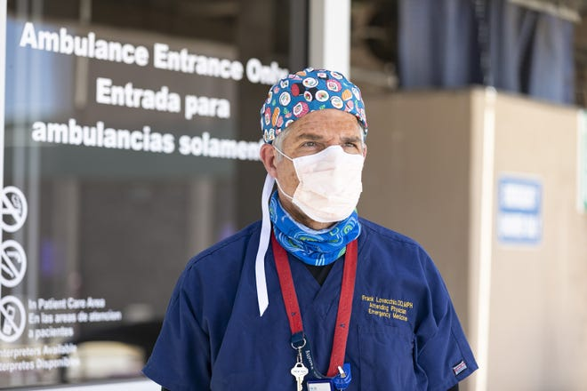 Dr. Frank LoVecchio stands outside of the ER at Valleywise Medical Center in Phoenix on June 20, 2020.