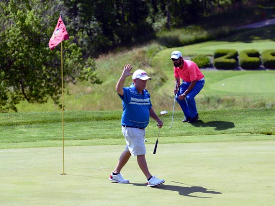 Brad Baker, of Warsaw, waves to the crowd after securing his fifth Zanesville District Golf Association Amateur tournament title on Saturday at Zanesville Country Club. Baker, who shot 75, tied Adam Lescalleet for the second-most Am titles of all time.