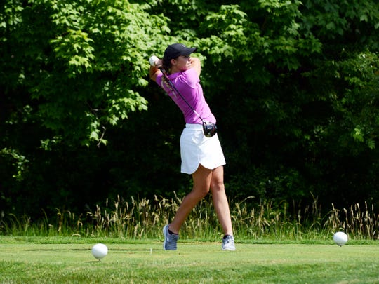 Joslyn Goins hits a tee shot during the final round of the Zanesville District Golf Association Amateur tournament on Saturday at Zanesville Country Club. Goins, from Zanesville, won the Women's Amateur by three shots.