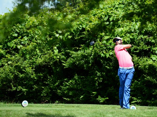 Buckeye Trail grad Jed Burga hits his tee shot on the 14th hole during the final round of the Zanesville District Golf Association Amateur tournament on Saturday at Zanesville Country Club. Burga finished tied for second, two shots behind champion Brad Baker.