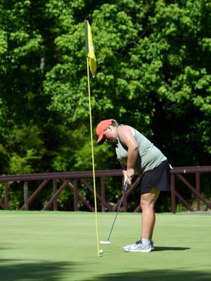 Crooksville's Riley McKenzie putts on the 15th hole during the final round of the Zanesville District Golf Association Amateur tournament in 2020 at Zanesville Country Club.