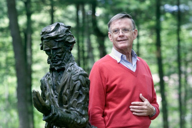 Robert  D. Richardson, author on Henry David Thoreau and Ralph Waldo Emerson, stands by a statue of Thoreau at Walden Pond Reservation on May 20, 2002.