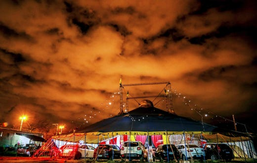 People in their cars attend a show at the Las Vegas Circus in Porto Alegre, southern Brazil late on June 20, 2020. Closed since March due to the coronavirus pandemic, Las Vegas Circus returned to activity with a drive-in show, which includes those circus artists with less risks of spreadingthe COVID-10 pandemic.