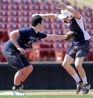 The Xavier High School baseball team practices June 19 at Neuroscience Group Field at Fox Cities Stadium in Grand Chute.