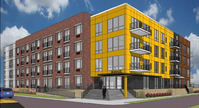 A rendering shows the south and east facades of the planned downtown Neenah apartment building. The view is from Main Street.
