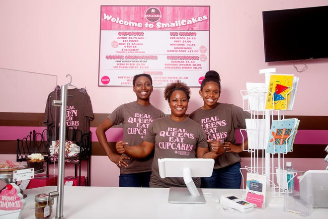 Brandy Mills, center, owner of TBM Smallcakes Cupcakery & Creamery, with employees Jillian Brown, left, and Anaiya Adwaters, right, June 19, 2020.