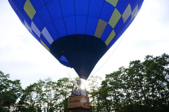 Phil Clinger launches a hot air balloon Sunday in Hickory Corners