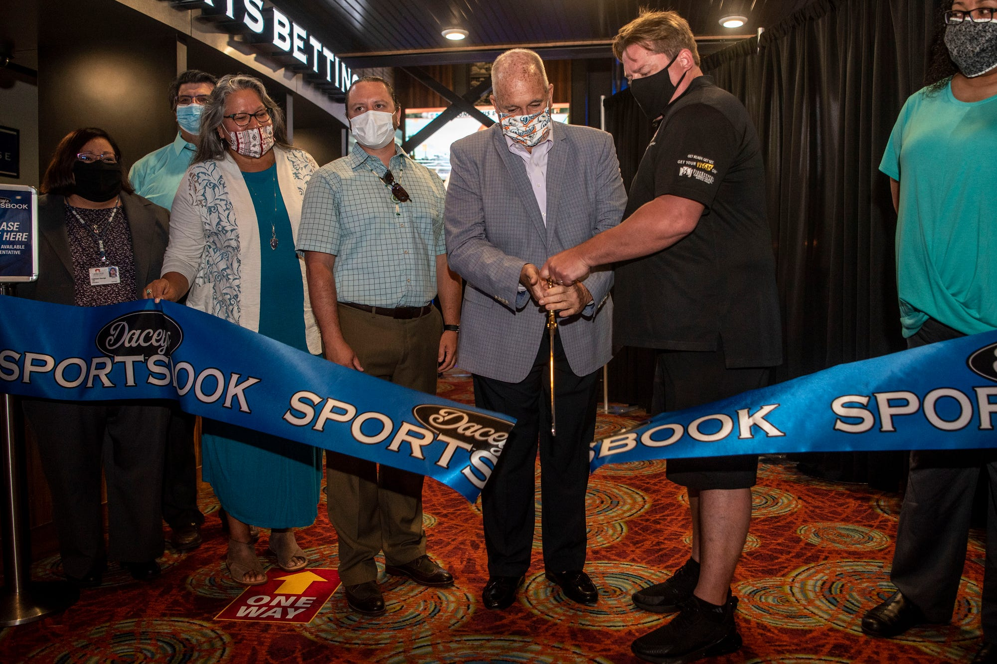 Jim Dacey and Jamie Stuck cuts the ribbon to FireKeepers Casino Hotel's Dacey's Sportsbook for sports betting on Monday, June 22, 2020 in Battle Creek, Mich.