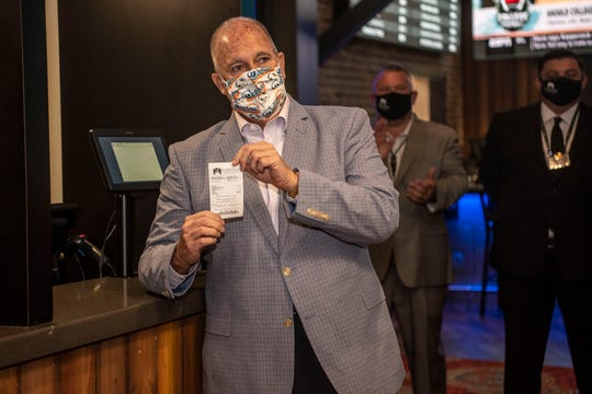 Jim Dacey, the namesake for Dacey's Sportsbook, places the first sports bet at FireKeepers Casino Hotel on Monday, June 22, 2020 in Battle Creek, Mich.