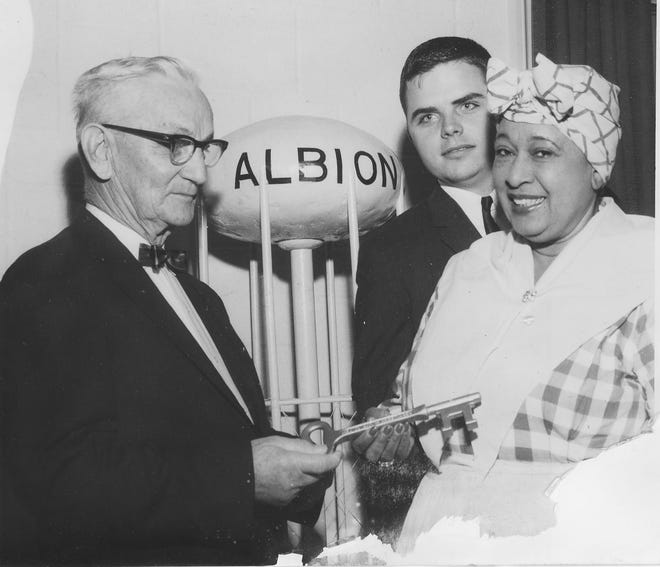 """Aunt Jemima,"" a fictional character created by Quaker Oats, is presented a key to the city of Albion by Mayor Hugo A. Rieger as Thomas Cook of the Albion Jaycees looks on in January 24, 1964. The character, portrayed by Edith Wilson, was in town to help raise money for the March of Dimes."