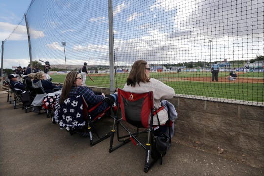 In this photo taken Tuesday, June 16, 2020, Yakima Valley Pepsi Pak baseball fans watch the Senior Legion team play a game in Selah. The team continues to play games despite not being approved to do so by the Yakima Health District or allowed under state restrictions so long as Yakima County remains in Phase 1 of the coronavirus reopening.