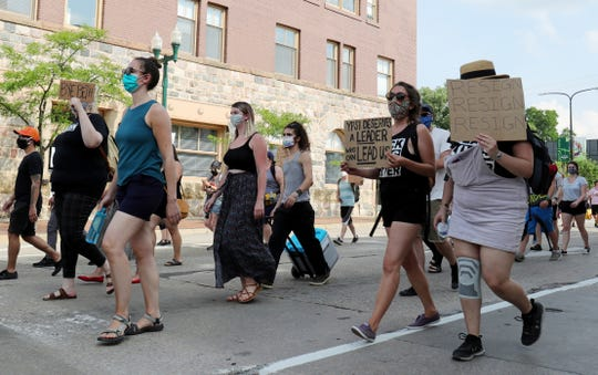 Protesters gathered in front of Ypsilanti City Hall to demand the resignation of mayor Beth Bashert Monday, June 22, 2020.