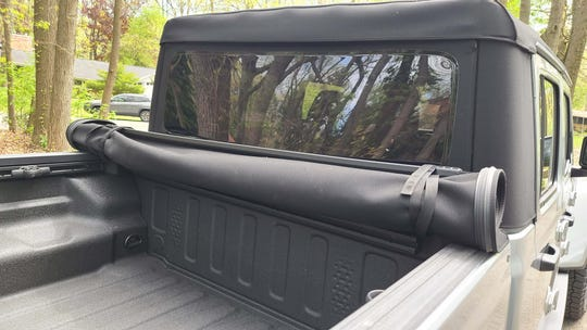 The bed tonneau cover can be rolled up out of the way on the 2020 Jeep Gladiator Mojave.