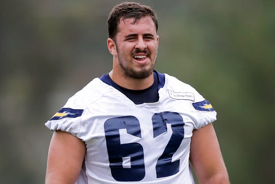 In this May 31, 2016, file photo, San Diego Chargers rookie center Max Tuerk takes part in NFL football training camp in San Diego.