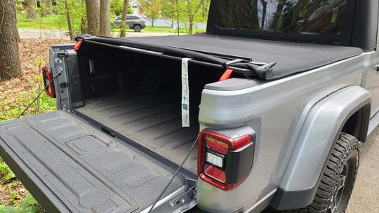 The 2020 Jeep Gladiator Mojave is available with a bed cover to help keep luggage/cargo out of the elements.