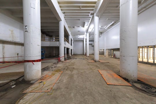 Racks for parking will be built in the basement that formerly housed printing presses for the Detroit Free Press. The fully automated parking structure is called AUTOParkit.