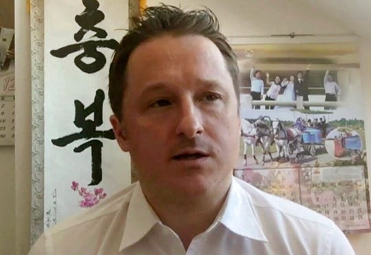 In this March 2, 2017, file image made from video, Michael Spavor, director of Paektu Cultural Exchange, talks during a Skype interview in Yanji, China.
