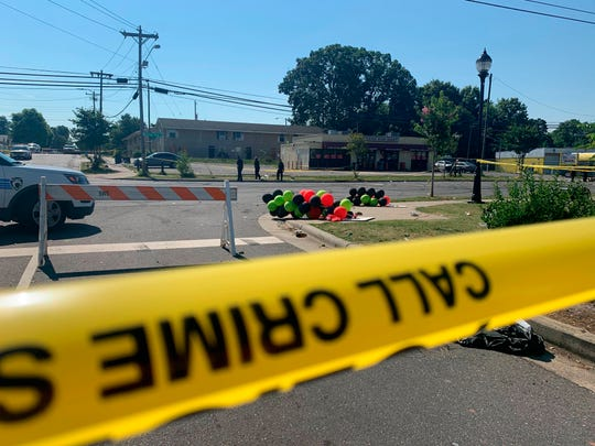 Police tape is seen near the scene of a shooting early Monday in Charlotte, North Carolina, that resulted in two deaths and several more people wounded or injured.